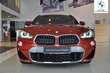 BMW X2 xDrive20d Pomarańczowy używany Prawy tył